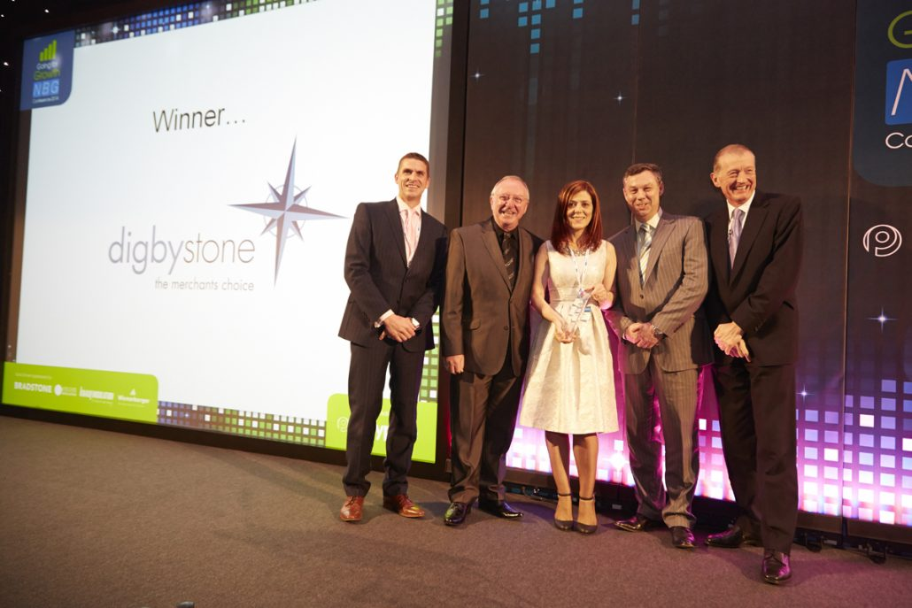 Claire & Darren Digby on stage accepting their award for Civil Engineering and Landscaping Supplier at NBG Conference in 2014.